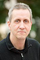 En porträttbild på Peter Ringman, som tittar in i kameran.